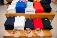 Exclusive Ladies Lacoste polos in assorted colours, $98.00 and visors, $30.00 on the main fashion floor.